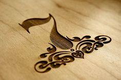 Laser cut into wood - number Seven