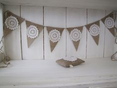 Pennants with burlap and doilies.