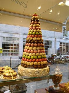 "In France, the traditional wedding cake called ""croquembouche"". It is a tall tower of cream-filled pastries coated in caramel and formed into a pyramid shape."