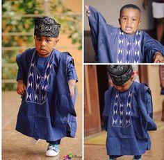 Okay, how cute is this gorgeous boy in his ágbádá, too cute. #Ngerian #kidsfashion #ágbádá #fílá #fashionista #photography #stylish #cutenessoverload #Nigerianfashion #littleprince #Africanprint #GuineaBrocade #embroidery #shoes #toocute #Africanwaxprint #fashionphotography #awwwwww #blue #boysfashion