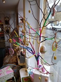 "I just don't like the colour brown, so when I found the ideal branch for our Easter window display I just could not resist making it just a touch more colourful! Growing up in Germany we always had an Easter ""Tree"" but now the trend seems to …"