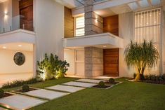 White Facade Home: Beautiful Houses http://www.beautiful-houses.net/2018/01/white-home-facade-with-concrete-wood.html