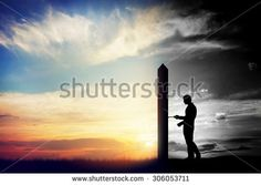 Man trying to open door to a new better world. Conceptual change, two worlds, hell and paradise.  - stock photo