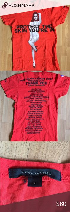 """Marc Jacobs Protect the skin you're in shirt S Marc Jacobs T-shirt featuring his skin cancer awareness campaign called 'Protect the Skin You're In.' This sizzling image of Dita Von Teese is printed on a red t-shirt & was available at Jacobs boutiques. The money generated went to NYU Cancer Institute at NYU. Great condition- hard to find- no rips, tears, holes or stains! size S  The """"Protect The Skin You're In"""" campaign began in 2006 when Marc Jacobs persuaded celebs to disregard warnings…"""