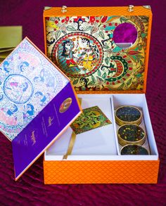 Wedding Invitations - Orange and Blue Box Wedding Invitation with Favors | WedMeGood  #wedmegood #indianinvitation #weddinginvitation #favors #box #indianwedding