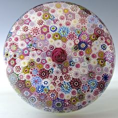 """Saint Louis {France} paperweight - Top dome shot of Saint Louis 1976 close packed millefiori piedouche paperweight. A large central Clichy-type pink rose is surrounded by a multitude of assorted, intricate, complex canes, including a signature/date cane. 3"""" w, 22.2 oz. - #0010"""