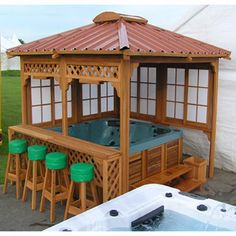 Gazebo w/ hot tub and bar w/ bar stools.  Changes: Round-Wrap around deck around hot tub w/ bar wrapping on the inside. Built in towel rack? Mesh screen around?