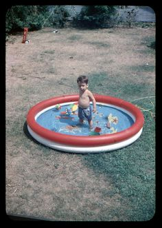"""Pool Time"" in 1955 (photographer unknown)...Oh my gosh....this could so easily be my brother...the toys in the pool, the little guys swimming trunks and of course the 'blow-up' pool."