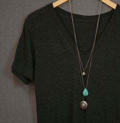 dress up a simple look with layered necklaces