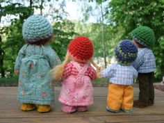 I love these sweet little dolls with their crocheted caps.  Lots more images of them on the link.