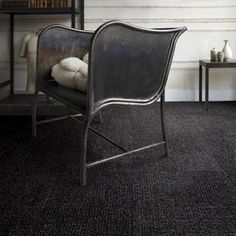 Dark grey berber carpet?  Looks classy!  Maybe for the office or theater, or even guest room.  Super great with white trim and silver / light furnishings.  Carpet tiles a great idea for us with the kids being small.  Pull up and replace.  Love that!