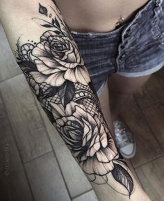 Black ink roses with a lace background. Tattoo by Dmitriy Tkach, an artist based in the Ukraine.