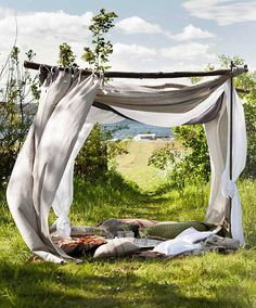 I love this idea, the natural stick frame with the big pillows and soft curtains.