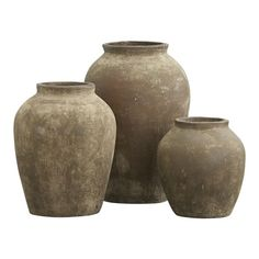 Olive Jars.  The massive scale of this architectural object is enhanced by a rich, rustic green oxidized finish to create the effect of an ancient artifact.