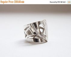 Hey, I found this really awesome Etsy listing at https://www.etsy.com/listing/32694039/on-sale-drawnwork-ring-fine-silver