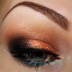 This awesome eye makeup is a beautiful combination of a copper eyeshadow shade and teal eyeliner. These vibrant peepers can be yours by using these products.