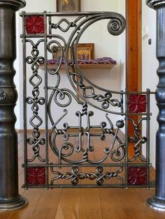 Wrought Iron gate by Stanislav Branovitskiy Used indoors, this would make a beautiful and functional baby or doggie gate
