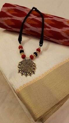 Raw silk with extra Ikkat blouse and matching necklace for ₹1995 Available at: www.facebook.com/Weavestore Matching Necklaces, Weave, Crochet Necklace, Silk, Facebook, Blouse, Jewelry, Fashion, Moda