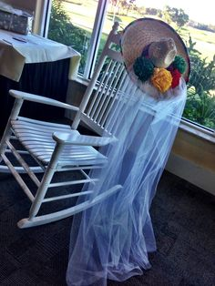 Mexican-themed Bridal Shower. To combine the two themes (fiesta and bridal shower), I took a sombrero and added white tule to it to make a fun and festive bridal veil. It added to the decor, and the bride-to-be put it on to pose for pictures.