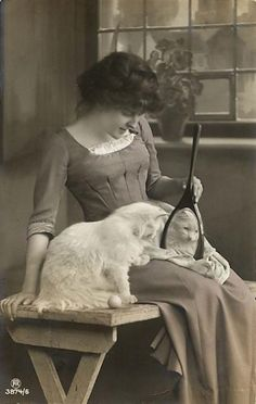 Elegance—young woman and kitty. Quite unusual! Is that a toy next to the cat? :)