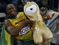 Jamaica's Usain Bolt holds up a 'Wenlock' London 2012 Olympics mascot, as he celebrates winning the men's 100m final during the London 2012 Olympic Games at the Olympic Stadium August 5, 2012. Bolt came first ahead of Blake who finished second and Justin Gatlin of the U.S. who placed third