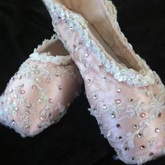 Delicate lace on pointe shoes with Swarovski rhinestones.