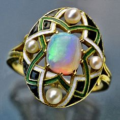 GEORGES FOUQUET 1862–1957  Art Nouveau Ring   Gold Enamel Opal Pearl  H: 1.8 cm (0.71 in)   Marks: Signed: G. Fouquet  French, c.1905