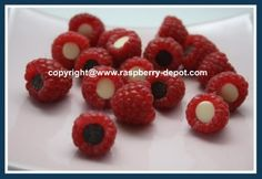 Simple! Gently rinse fruit and allow berries to dry on paper towel.  When the raspberries are dry, simply insert a dark chocolate or a white chocolate chips inside the raspberry.