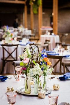 wildflower centerpiece for boho wedding / http://www.himisspuff.com/boho-rustic-wildflower-wedding-ideas/8/