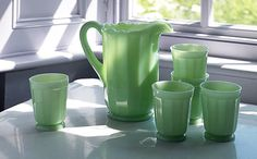 I love the color and style of this milk glass pitcher and glasses.