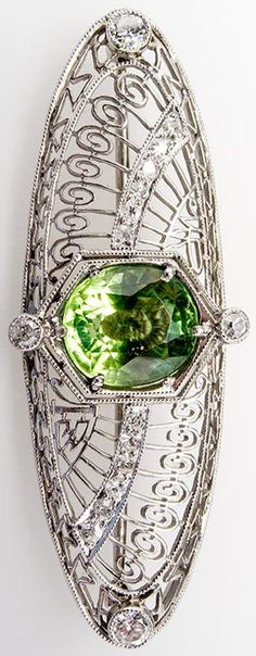 Antique Peridot & Diamond Brooch Openwork & Milgrain Platinum, circa 1930's.