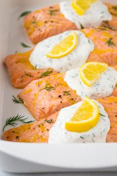 "Baked Lemon Salmon with Creamy Dill Sauce - ""This salmon recipe was a big success with my family. My husband loved it as did my 5 year old, and I even got my super picky 3 year old to eat it."" - cookingclassy.com"