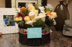 A baby bouquet gift basket. Great idea for baby showers!