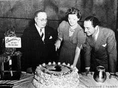"""Louis B. Mayer, Myrna Loy and William Powell celebrating Myrna's thirty-fourth birthday on the set of """"Another Thin Man"""""""