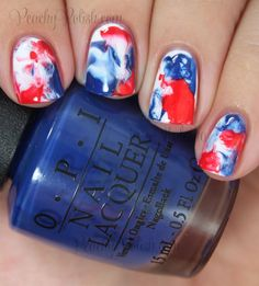 Red, white, and blue nail art ideas for Memorial Day and the 4th of July! Water marble red, white, and blue polish for a look that will have your friends asking you to do their nails next.