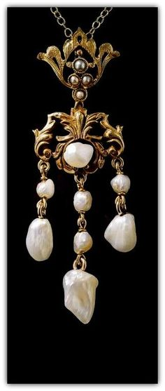 Turn-of-the-Century Freshwater Pearl Necklace. Three freshwater pearl dangles dance below a golden pearl-centered repousse garland surmounted by a lovely matching seed pear centered bail in this utterly delightful 2 inch long pendant necklace - circa 1900.