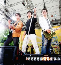 The Jonas Brothers~ rockin out on the stage~