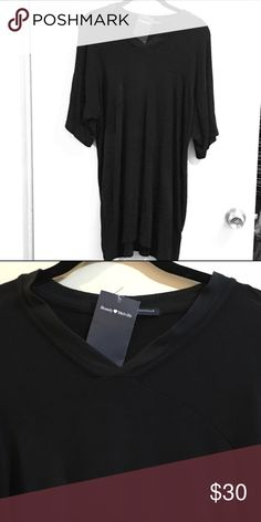 Brandy Melville black T shirt dress NWT. V neck T shirt dress. I have never seen it on Posh so I think it's somewhat Rare brandy. I bought this a while back just never wore it. Brandy Melville Dresses