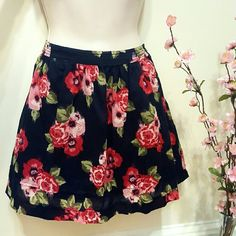 Floral skirt Pretty floral print! Red/pink flowers on navy blue. Skirt has 3 layers, including a layer of tulle in the middle (see 2nd pic), which helps gives it a full/flared look. 4 buttons closure half way down on one side.  Waist: 14.5 inches across.  Length: 15 inches.   See the current Sale Ad at the top of my closet ? Bundle & Save ? Or Make an Offer! Heritage 1981 Skirts A-Line or Full