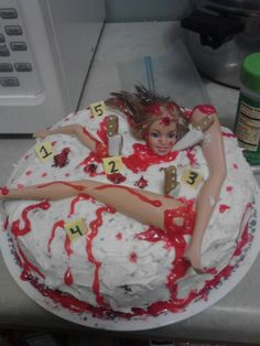 My crime scene cake for a halloween party. The cake is red velvet, the frosting is cream cheese, and then I used red tube frosting for the blood. I also washed the barbie with dish soap before she went on the cake and laid down plastic wrap covered in frosting where her head is. No one wants barbie hair in their cake....