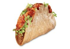 Jack in the Box New Enchilada Monster Taco | features a extra-long crunchy taco with a seasoned meat filling topped with shredded lettuce, melted cheddar cheese, and enchilada sauce.