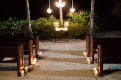 nighttime destination wedding on the beach that lights the way with candles. Photo by: http://hunterryanphoto.com/ Seen on: http://www.jetfeteblog.com/destination-weddings/beach-wedding-shoot-at-night