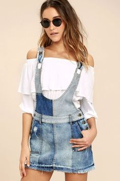 The Free People Patchwork Blues Blue Denim Pinafore Dress is bringing out our inner wild child! Layer your favorite top under this patchwork dress with distressed light and dark denim, adjustable straps, and side button closures. Fitted waist with belt loops and a four pocket design. Raw, mini length hem.