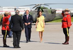 the yellow dress which flew up around her bottom and clearly showed her underwear or lack thereof.  silly choice for climbing out of a helicopter on a military tarmac with military official line up.