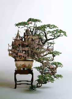TAKANORI AIBA    Takanori Aiba creates stunning sculptures that revolve around bonsai trees. Although they can be described as mini tree houses, that description does little to no justice to the scale and intricacy of Takanori Aiba's creations. These sprawling dioramas are more like mini communities than single homes.