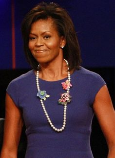 Have Flower Power We first saw this trio of flowers on Michelle Obama's appearance on The Ellen DeGeneres Show. She used them to fasten her cardigan, not to mention dress up her onscreen ensemble. Then, when the cornflower-blue, rose-pink mix and ombre-effect lilac made a second appearance on a string of pearls at the third presidential debate at Hofstra University in New York (left), we were floored! On a budget? Try the Long Pearl Necklace with Flowers ( at BetseyJohnson.com).