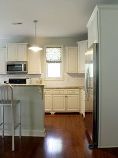 white cabinets, white subway tile, granite, wood floors