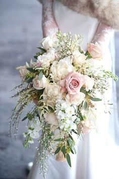 Need a bridal bouquet inspiration for your wedding? Consider the white bridal bouquet. While we love scoping out all of the innovative floral designs that are out there, a white bouquet will forever be timeless. But why white? Cascading Bridal Bouquets, Cascading Wedding Bouquets, Cascade Bouquet, Bride Bouquets, Bridal Flowers, Flower Bouquet Wedding, Floral Wedding, Wedding Colors, Bouquet Flowers