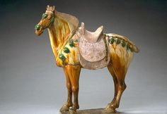 Glazed horse  from the Tang dynasty (618-907)–it is a quintessential Tang horse.
