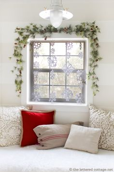 Straight rod above window...Snowflake Curtain::With Whispy Evergreen Garland and Red Berries. Lovely.